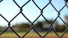 Outside Fence Looking in on Goalpost Stock Footage