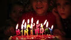 Blowing out candles Stock Footage