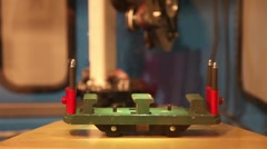 Robot assembles and disassembles a toy trolley, loop Stock Footage