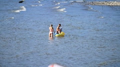 MVI 9724-couple playing with small child in River Stock Footage