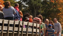 People unloading from hayride carrying pumpkins - stock footage