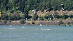 MVI wide panning shot of kiteboarders out in gorge Stock Footage