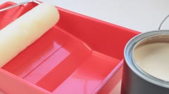 Pouring A Gallon Of Paint Into A Paint Tray With a Paint Roller Stock Footage