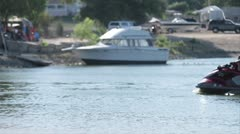 Static shot of family passing by on seadoo - stock footage