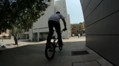 Bmx rider does a big tailwhip down a stair set Stock Footage