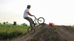 Bmx rider crashes trying a tailwhip on a dirt jump Stock Footage