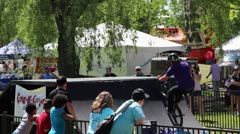 bmx rider des a flair (backflip 180) on a quarter pipe - stock footage