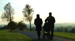 family with baby buggy silhouette - stock footage