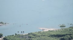 Stationary overview shot of lake activites Stock Footage