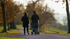 family with baby buggy - stock footage
