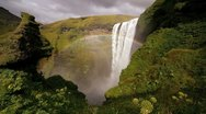 Skogafoss waterfall and rainbow South coast Iceland, Europe Stock Footage