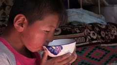 Mongolia: Drinking from a Bowl Stock Footage