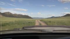 Mongolia: POV Shot Driving on a rural road in Mongolia Stock Footage