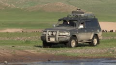 Mongolia: LandRover crossing a stream Stock Footage