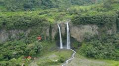 Cable car over Manto de la Novia waterfall, Ecuador Stock Footage