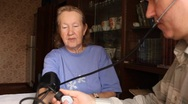 Stock Video Footage of son, measures the blood pressure in elderly mother