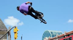 Bmx rider does a huge double tailwhip over a jump Stock Footage