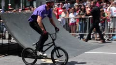 Bmx rider dos a perfect superman on a jump Stock Footage