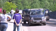 Cars stopped at emergency supply station Stock Footage