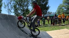 Bmx rider does a footjam nosepick tailwhip Stock Footage