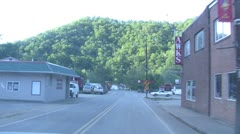 Driving through small town effected by flood Stock Footage