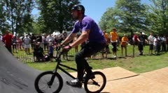 Bmx'er does a tailwhip to tailtap Stock Footage