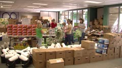 Flood victims at emergency supplies station Stock Footage