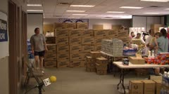Emergency station filled with water and other supplies for flood victims Stock Footage
