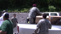 National Guardsmen and relief workers unloading supplies Stock Footage