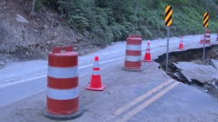 Partially washed out road due to flood Stock Footage