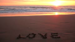 Love - Romantic sunset over sandy beach - stock footage