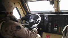 Soldier driving a military vehicle - stock footage