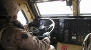 Soldier driving a military vehicle Stock Footage