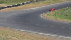 Formula One Race Car through turn, wideshot - stock footage