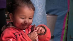 Mongolia: Eating a Candy Bar - stock footage
