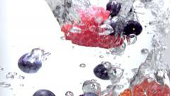 Fruits Falling in to the Water Slow Motion Stock Footage