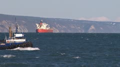 Tugboat Redoubt passing by Tanker Stock Footage