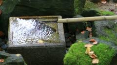 Water Fountain in Japanese Garden in Fall Season Stock Footage