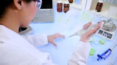 Lab Assistant Using Microscope Stock Footage