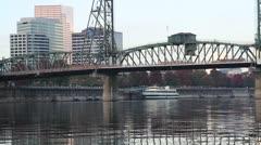 Hawthorne Bridge and Downtown Portland Along Willamette River Stock Footage
