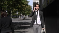 Young man speaking with telephone and walking in the city Stock Footage