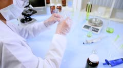 Asian Chinese Female Using Laboratory Equipment Stock Footage