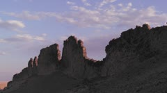 Time lapse of rocky outcroppings near Shiprock, New Mexico. - stock footage