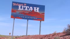 A roadside sign welcomes visitors to Utah. Stock Footage