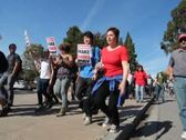 Stock Video Footage of Wide Low Angle UCLA Student Occupy Protest March