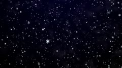 Snowfall on darkly dark blue background. Snowflakes. - stock footage