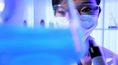 Female Lab Technician Doing  Forensic Research Experiments - stock footage