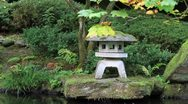 Waterfall with Stone Lantern in Japanese Garden Stock Footage