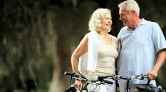 Retired Couple Cycling for Fitness Stock Footage