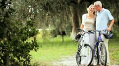 Active Mature Couple Cycling for Exercise Stock Footage